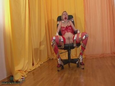 Slave Lucilla strapped to chair